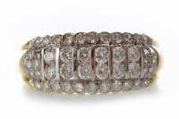 Lot 526-DIAMOND DRESS RING with two central rows of...