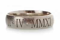 Lot 527-GENTLEMAN'S PLATINUM DIAMOND SET WEDDING BAND...