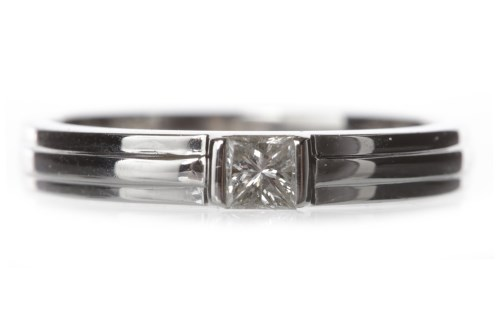 Lot 536-DIAMOND SET BAND set with a single princess cut...