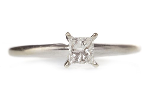 Lot 537-DIAMOND SOLITAIRE RING with a four claw set...