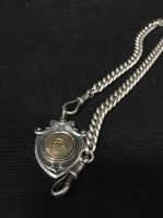 Lot 14-SILVER ALBERT CHAIN with silver fob decorated...