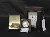 Lot 82-CARRIAGE CLOCK contained within a leather travel...