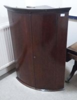 Lot 1738-GEORGE III MAHOGANY BOW FRONT HANGING CORNER...