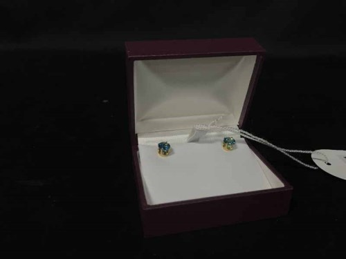 Lot 33-EIGHTEEN CARAT GOLD STUDS set with blue gemstones